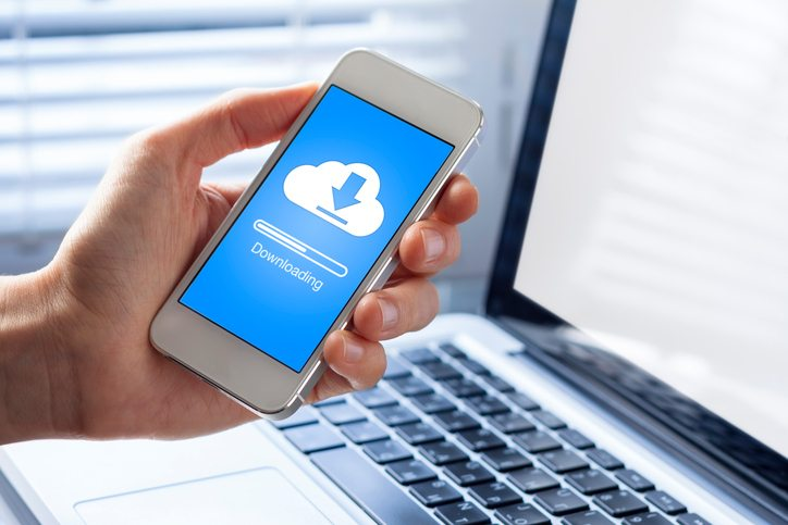 Image of hand downloading app from cloud to smartphone